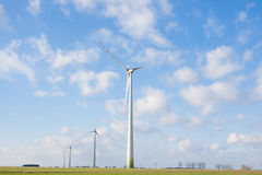 Windmill wind power plant. On the field Royalty Free Stock Photography