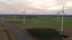 Windmill wind power technology - aerial drone view on wind power, turbine, windmill, energy production - green stock video footage