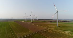Aerial wiev of windmills farm. Power Energy Production. Windmill and Wind power technology background. Aerial view on Wind Power, Turbine, Windmill, Energy stock video footage
