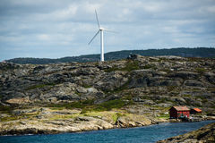 Windmill. Wind turbine on top of a mountain at the Swedish westcoast royalty free stock image