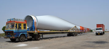 Windmill wing loaded on truck. Gandhidham Highway, Gujarat on 3rd May 2012 - Truck transporting a Windmill wing for installation and maintenance Stock Photo