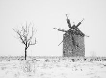 Windmill in winter Stock Images
