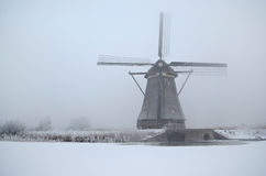 Windmill in winter in Holland Stock Images
