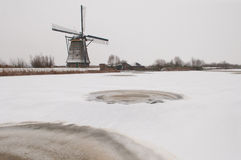 Windmill in winter landscape Stock Images