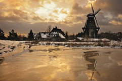 Windmill in winter landscape Royalty Free Stock Photo