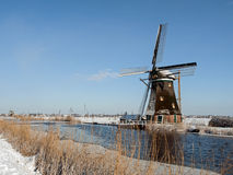Windmill in winter setting Royalty Free Stock Photography