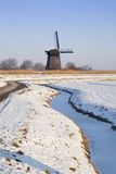 Windmill in winter time with snow Royalty Free Stock Photos