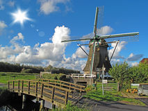 Windmill with wooden bridge. In beautiful weather, Netherlands, Europe Royalty Free Stock Images