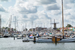 Windmill and yachts in Hellevoetsluis, Netherlands. Yachts and windmill in the harbour of Hellevoetsluis, Netherlands stock images