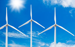 Windmills. Clean Energy, Windmills with Sun and Blue Sky royalty free stock photo