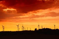 Windmills. On the horizon and sunset Stock Image