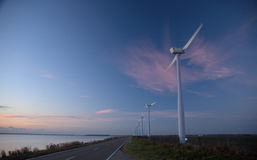 Windmills. In dutch countryside at sunset. These  provide enviromentally safe electricity Stock Photo
