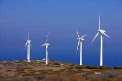 Windmills. Job windmills.Mountain landscape against the sea Stock Image