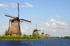 Windmills. Dutch windmills in front of water Royalty Free Stock Image