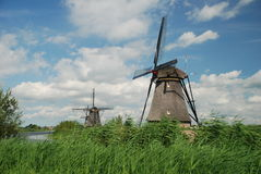 Windmills. Famous series of dutch windmills in Kinderdijk, Netherlands Royalty Free Stock Image