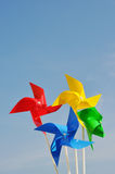 Windmills. Multicolored Windmills against blue sky with copyspace for your text Stock Images