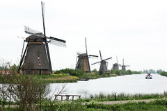 Windmills. Old windmills on the channel with ship Royalty Free Stock Photography
