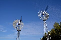 Windmills. Small windmills to produce electricity royalty free stock images