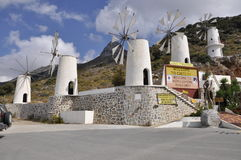 Windmills. And entrance to the Museum of the ancient person, Greece, lake of Crete Stock Photography