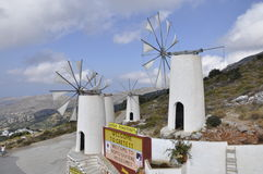 Windmills. And entrance to the Museum of the ancient person, Greece, lake of Crete Stock Photo