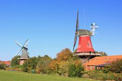 Windmills. In Greetsiel, East Frisia, Lower Saxony, Germany Royalty Free Stock Image