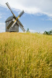 Windmills. The old windmill costs in the field of mature grain Royalty Free Stock Photos