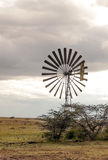 Windmills in the African savannah. Is a picture vertically on a cloudy day Royalty Free Stock Images