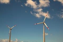 Windmills against bright blue sky. Modern windmills against bright blue sky Royalty Free Stock Photo