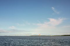 Windmills in Almere Pampus, 10 windturbines in a cluster. royalty free stock images