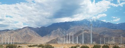 Windmills Along the Mountains and Freeway on a Cloudy Day stock photos
