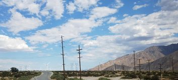 Windmills Along the Mountains and Freeway on a Cloudy Day royalty free stock images