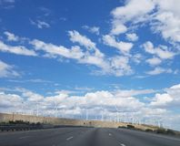 Windmills Along the Mountains and Freeway on a Cloudy Day stock image