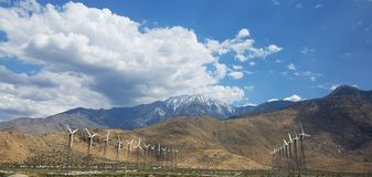 Windmills Along the Mountains and Freeway on a Cloudy Day royalty free stock photo