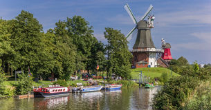 Windmills along the river in Greetsiel Royalty Free Stock Photography