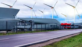 Windmills, alternative energy . Power generating windmills. Wind turbines . Closeup Wind turbine power generator on blue sky stock image