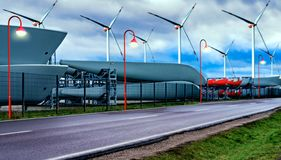 Windmills, alternative energy . Power generating windmills. Wind turbines . Closeup Wind turbine power generator on blue sky . street lamp stock photo