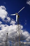 Windmills - Alternative energy source. Environmentally friendly power plant against cloudy sky Stock Photos
