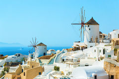 Windmills and apartments in Oia town, Santorini Stock Image