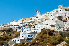 Windmills and apartments in Oia village, Santorini Royalty Free Stock Images