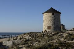 Windmills in apulia portugal Royalty Free Stock Photo