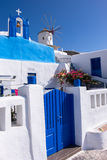 Windmills and architecture of island Santorini, Greece Royalty Free Stock Image