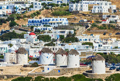 Windmills and buildings on sunny day in summer, island of Mykonos, Greece Stock Image
