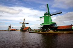 Windmills. Buildings and windmills in Zaanse Schans ethnographic museum in Netherlands royalty free stock photos