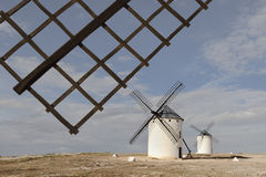 Windmills at Campo de Criptana, Ciudad Real, Spain. Medieval windmills on a hill overlooking the town of Campo de Criptana, Ciudad Real province, Castilla la Stock Images