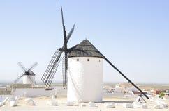 Windmills in Castile village. Windmills  in `Campo de Criptana`, a town of the province of Ciudad Real, Castile-La Mancha, Spain Stock Photo