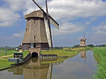 Windmills at the canal Royalty Free Stock Image