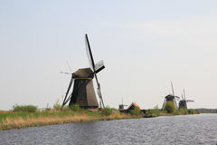 Windmills on the canal bank. Royalty Free Stock Photo