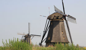 Windmills on the canal bank. Stock Photography