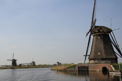 Windmills on the canal bank. Stock Photo