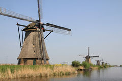 Windmills on the canal bank. Stock Photos